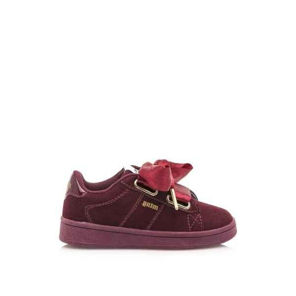 Sneaker en serraje con lazo